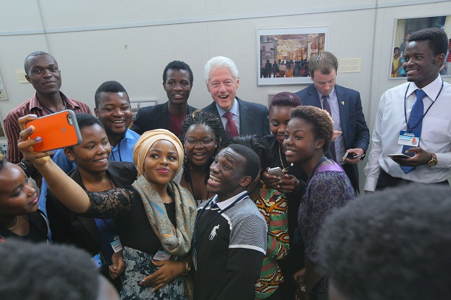 Posing for a selfie with President Bill Clinton, the founding chairman of the Clinton Global Initiative
